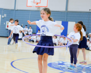 Photo by Beth Intro AJA third-grader Dassie Chasen opens the flash mob with a hula hoop.