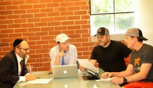 A Torah study session at FilmTribe involves (from left) Rabbi Ariel Asa; Yaakov Daniels, head of business development; Elan Hertzberg; and Isaac Italiaander, an intern in mechanical engineering from Miami University in Ohio.