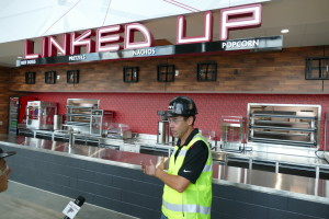 Mike Gomes shows off one of the completed concession stands at Mercedes-Benz Stadium.