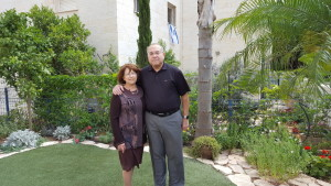 Edie and Mort Barr stand in their garden in Ramat Beit Shemesh, where they moved at the end of March.