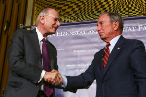 Stuart Eizenstat (left) welcomes Michael Bloomberg to Ahavath Achim Synagogue on July 19. (Photo by Chris Savas/Bloomberg)