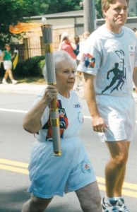 Helen Spiegel carries the Olympic torch for the 1996 Atlanta Games.