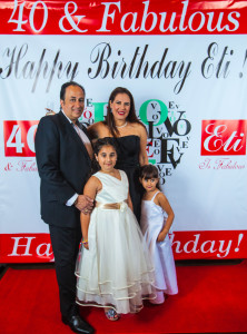 Eti Lazarian, with husband Chaz and two of their daughters, celebrates her 40th birthday recently at Spring Hall.