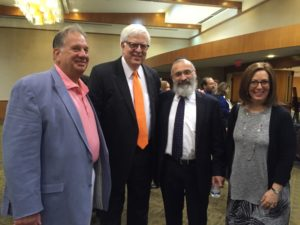 The pre-lecture reception at Beth Tefillah brings together (from left) Jeff Kunkes, Dennis Prager, Rabbi Yossi New and Beth Shapiro.