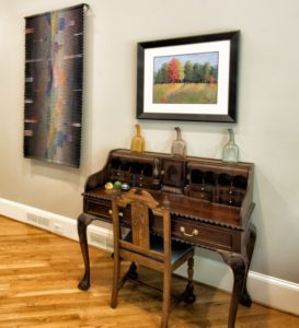 Judy Robkin says the Gunther textile breathes life into this room, which also features an authentic Chippendale desk and a watercolor by her sister, Anita Stein.