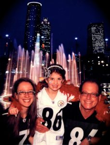 Ana, Sasha and Eric Robbins leave no doubt about their favorite NFL team.