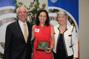 Creating Connected Communities' Amy Zeide accepts the Mary and Max London People Power Award from Howard Feinsand and Sandy London at the annual meeting of the Jewish Federation of Greater Atlanta in June.