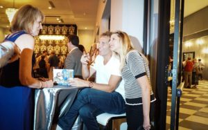 Photo by Sara Vogt Jesse Itzler signs books with his wife, Spanx CEO Sara Blakely.