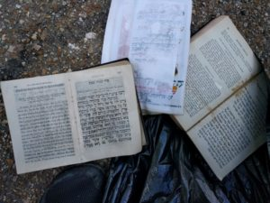 These prayer books, pulled from several flooded houses, were brought to the synagogue for proper disposal.