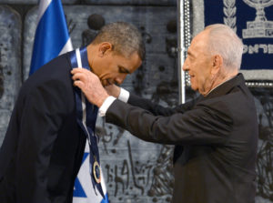 President Barack Obama is awarded the President's Medal of Honor for his contribution to the safety of Israel and mankind by Israeli President Shimon Peres in Jerusalem in 2013. (GPO photo)