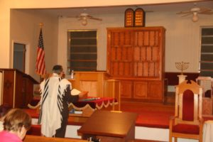 Rabbi Mark Kunis leads Mincha on Sept. 14, the first service in Shaarei Shamayim's permanent home.