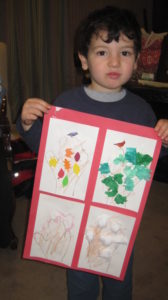 Avi has created a tree for all seasons at a Training Wheels Tu B'Shevat session.