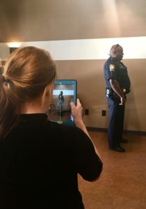 A Brookhaven police officer receives a digital posture screen at Complete Spine Solutions.