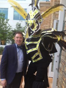 Breman Museum Executive Director Aaron Berger hangs out with a big bird at the Wildest Party of the Year, a museum benefit in April 2015.