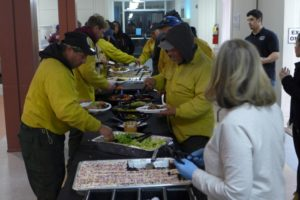 Members of the firefighting crews staying at Camp Ramah Darom take a break from battling the fires to eat. (photo by Jerry Cohen)