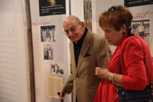 "Holocaust survivor Herbert Kohn visits the ""Georgia Journeys"" exhibit. (Photo courtesy of the Museum of History and Holocaust Education)"
