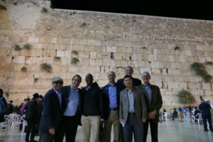 Timothy Denning, Binghe Wang, Geert de Vries and other members of the Conexx delegation stop at the Western Wall.
