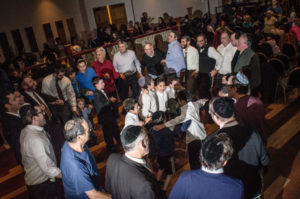 Men and boys dance at Congregation Ariel during the Simply Tsfat concert.