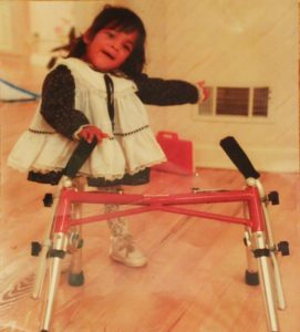 When a physical therapist suggested a wheelchair for Sarah around age 18 months, her mother decided to try a walker first, and Sarah took off.