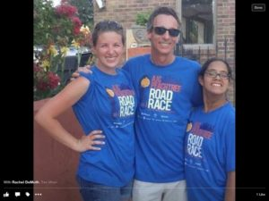 Sarah Kalins attends this year's Peachtree Road Race with her sister, special education teacher Rachel DeMuth, and their father, Jeff Kalins.