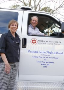 Laraine and Lowell Fine check out the ambulance they are giving Israel before the dedication ceremony Nov. 25.