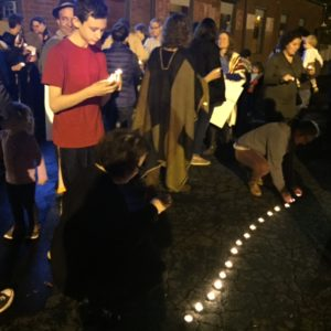 Participants make use of tealights to draw the line.