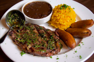 FuegoMundo specializes in South American fare, such as a meal of steak, rice and beans, and fried plantains.