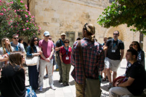 Tour guide Koren Eisner speaks to the HMI group in Jerusalem.