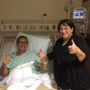 With his wife, Judy, at his side, Shai Robkin recovers at Emory University Hospital.