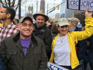 Photo by Leah Harrison Congregation Bet Haverim Rabbi Josh Lesser (left) marches in Atlanta with the Jewish Community Relations Council's Noah Appley and Elizabeth Appley.