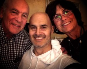 Scott Selig, shown with parents Steve and Janet Selig, has gone through radiation and chemo treatments and had an operation on his liver, and he has been accepted into a research trial.