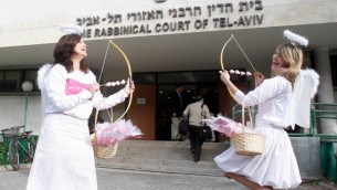 Israeli women, dressed for Valentine's Day, are seen outside the Rabbinical court in Tel Aviv (photo credit : Roni Schutzer/Flash90).