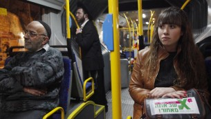 Headed for disaster? A secular Israeli woman on board a gender-segregated bus in Jerusalem. (Photo credit: Miriam Alster / Flash90)