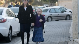 Bullying society. The ordeal of eight-years-old Naama Margolese (here pictured with her mother on her way to school) has been one of the catalysts of the recent debate regarding ultra-Orthodox extremism. (Photo credit: Kobi Gideon / Flash90)