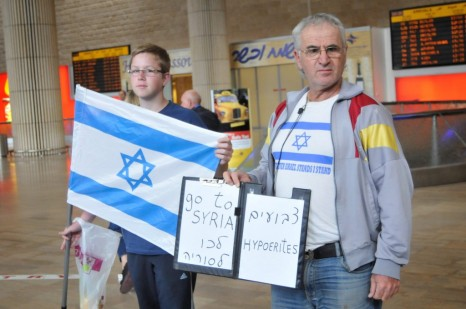 What a difference a letter makes. An anti-flytilla activist holds a sign that reads 'Go to Syria, hypoerites' at Ben Gurion Airport, Sunday (photo credit: Yossi Zeliger/Flash90)