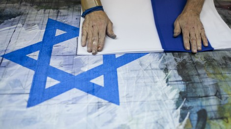 Israeli workers making a flags of Israel at the Berman's Flags and Embroidery factory in Jerusalem (photo credit: Yonatan Sindel/Flash90)
