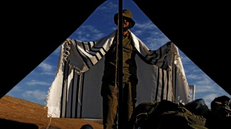 An Orthodox IDF soldiers at prayer (photo credit: Abir Sultan/Flash90)