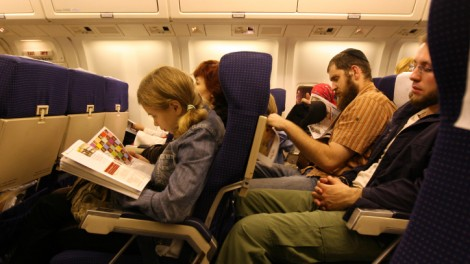 Passengers on an El Al flight (photo credit: Anna Kaplan/Flash90)
