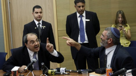 Arab MK Ahmed Tibi (L) argues with right-wing MK Michael Ben Ari (R) about cigars (Miriam Alster/Flash 90)