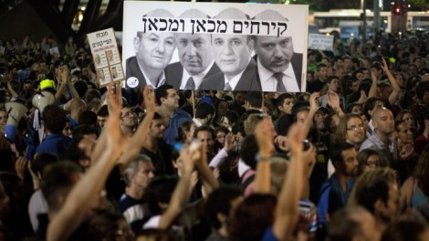 'There were clearly few, if any, right-wingers in the crowd.' Protesters hold a placard denigrating Netanyahu and members of his government (photo credit: Matanya Tausig/Flash90)