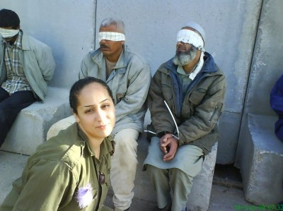 Eden Abergil poses with bound Palestinian detainees in this photo uploaded to her Facebook wall in August 2010 (via Facebook)