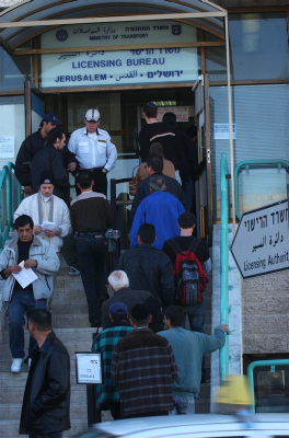 Feels like home. Standing in line outside the Licensing Bureau in Jerusalem (photo credit: Flash 90)