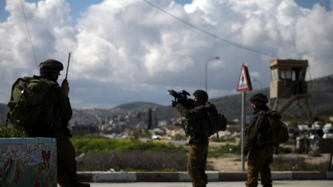 Bellicose and sadistic? Israeli soldier at the Hawara checkpoint south of the West Bank city of Nablus (photo credit: Abir Sultan/Flash90)