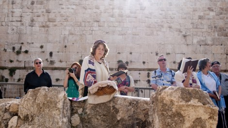 Anat Hoffman of the Women of the Wall reads from the Torah at Robinson's Arch outside of the Western Wall (photo credit: Hadas Parush/Flash90)