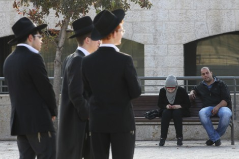 An Arab couple and ultra-Orthodox Jewish Men near Jerusalem's Old City (photo credit: Nati Shohat/Flash90)