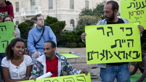 'For you, too, were a stranger in the Land of Egypt,' reads a sign at an anti-racism protest outside the Prime Minister's Residence in Jerusalem in May (photo credit: Yonatan Sindel/Flash90)