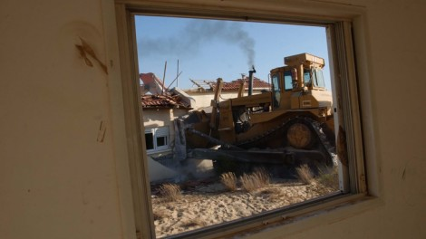 A bulldozer demolishes a house in the settlement of Pe'at Sadeh during the 2005 disengagement from Gush Katif. Has the time come for a large scale 'disengagement' from the West Bank? (photo credit: Flash90)
