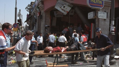 An injured girl is evacuated from the scene of the Sbarro bombing in Jerusalem, August 9, 2011 (photo credit: Flash9
