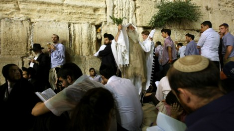 Orthdox men pray at Jerusalem's Western Wall on Tisha B'Av (photo credit: Kobi Gideon/Flash90)