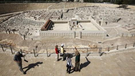 Tourists look at a model of the Second Temple on display at the Israel museum in Jerusalem (photo credit: Miriam Alster/Flash90)
